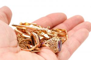 thumb_bigstock-Gold-ornaments-in-a-hand-15502553