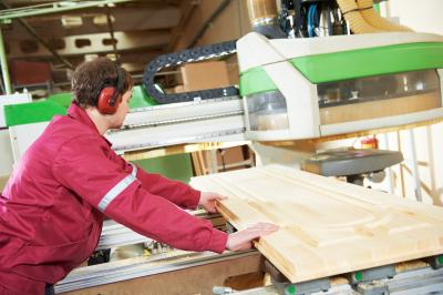 bigstock-industrial-carpenter-worker-op-94624322