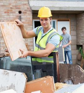 bigstock-Builder-Putting-Waste-Into-Rub-109211258